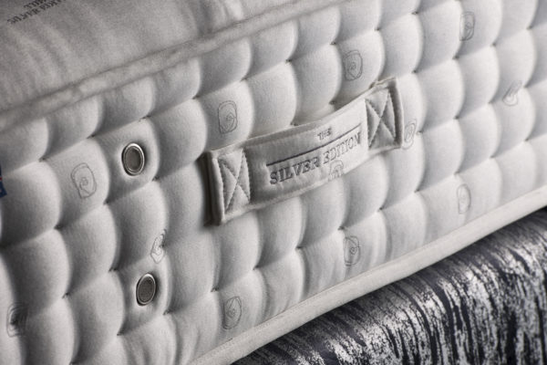 Silver Edition mattress from EPOC Handcrafted Beds with flag stitched turning handles and hand side stitching